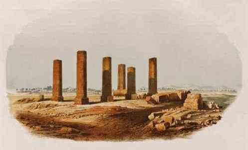 Six broken columns and some rubble stand in a field, all that remain of Amara West.