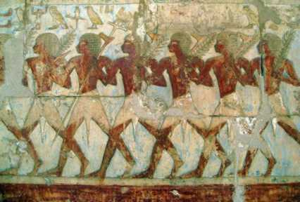 Queen Hatshepsut's men bring aromatic tree branches from foreign lands.