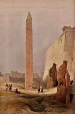 Men are tiny below the Obelisk, statues and the huge pylon at the north entrance to Luxor.