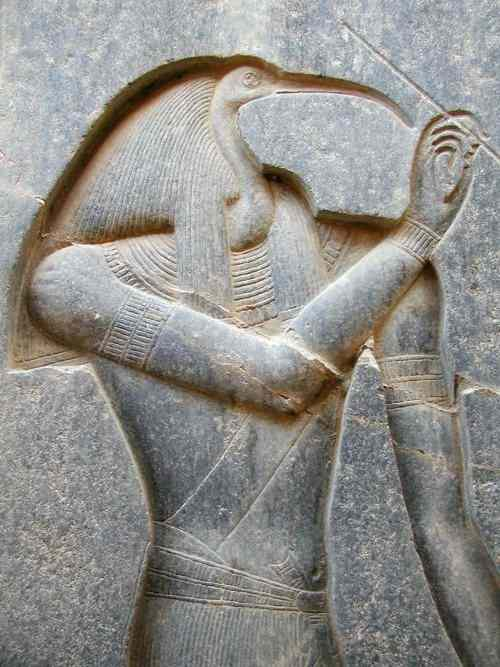 Thoth has the head of a long-billed bird (ibis) and carries a stylus.