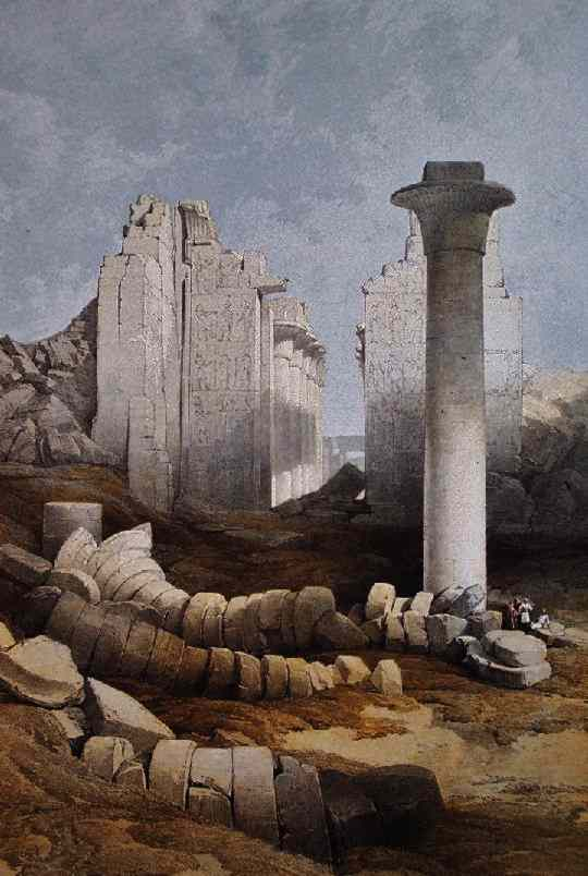 A small group of men is almost lost in a field of overturned columns.